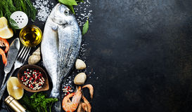 delicious-fresh-fish-dark-vintage-background-aromatic-herbs-spices-vegetables-healthy-food-diet-cooking-48616228